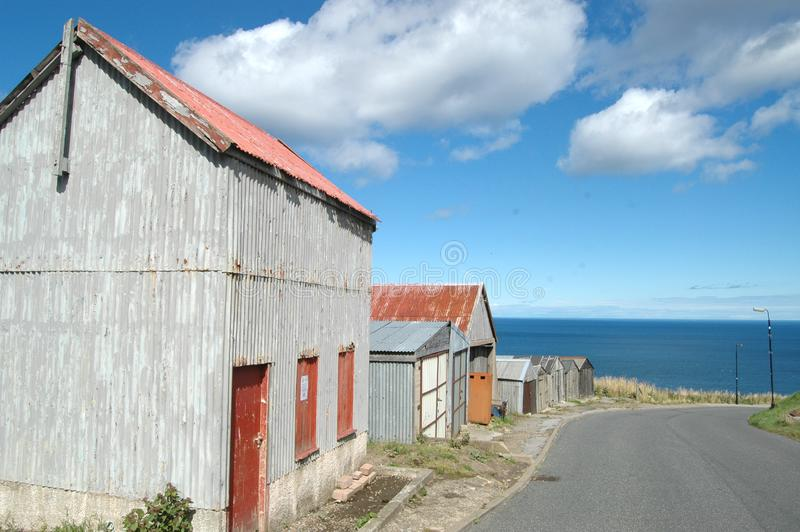 Sheds by the sea, Gardenstown, Scotland royalty free stock images