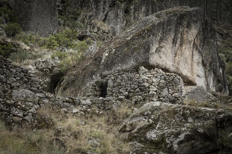 Sheepfold with a stone wall under a boulder to keep in livestock - Manteigas stock photos