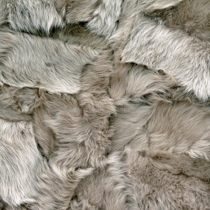 Sheepskin Patchwork. Patches of decorative sheepskin sewn together stock images