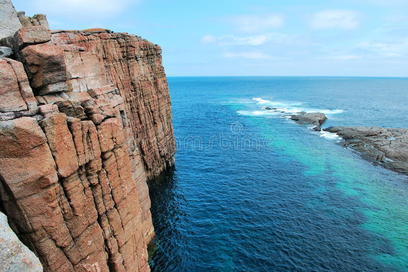 Sheer coastal rock formation. Scenic view of sheer coastal rock formation called the beamer near Flatrock, Newfoundland and Labrador, Canada stock photography