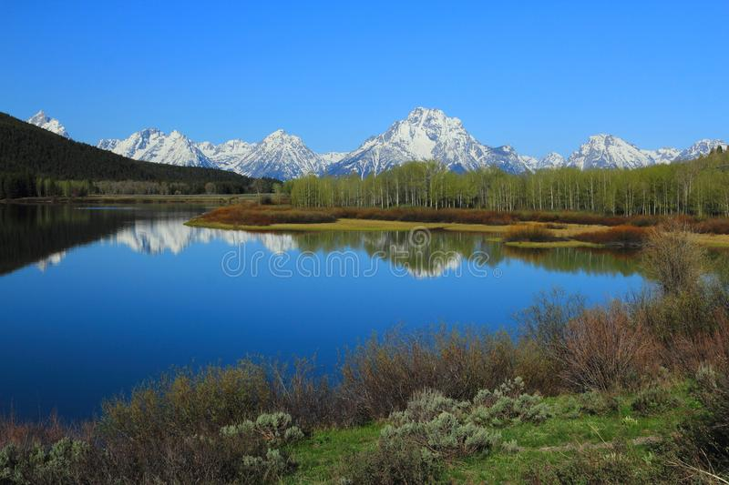 Peaceful Landscape of Grand Teton Range reflected in Oxbow Bend of Snake River, Grand Teton National Park, Wyoming, United States. Peaceful landscape of the stock photos