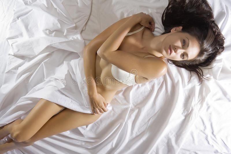 Download On sheet stock image. Image of calm, relax, bedding, attractive - 10831895