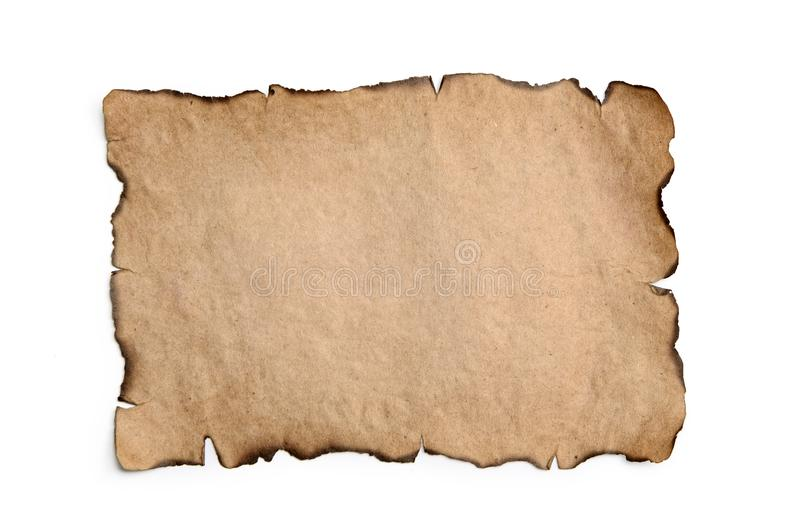 Sheet of burnt, vintage paper isolated on a white background royalty free stock images