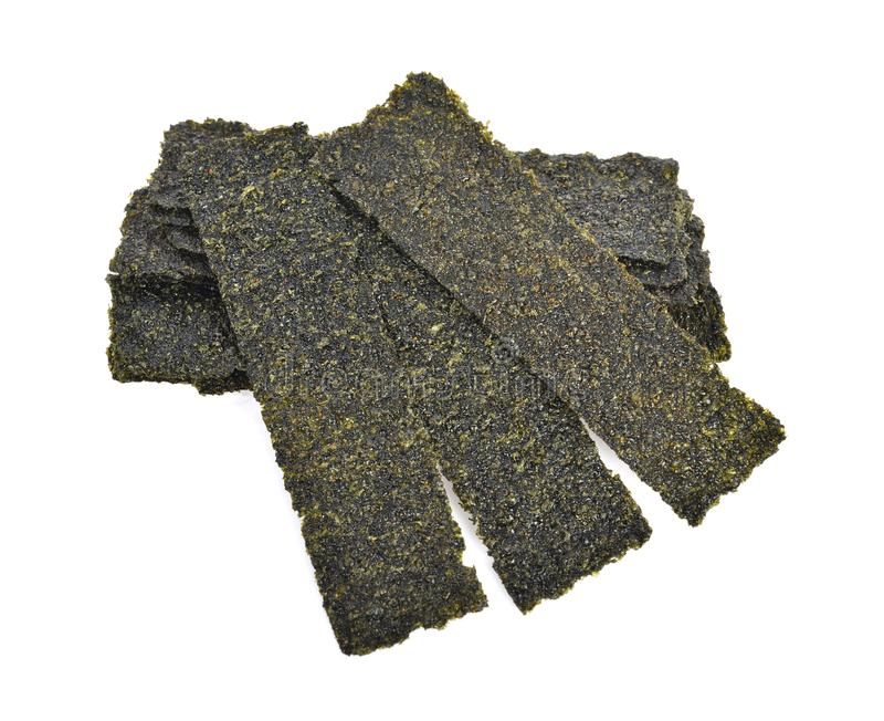 Sheet of dried seaweed, Crispy seaweed isolated on white background. The Sheet of dried seaweed, Crispy seaweed isolated on white background royalty free stock photo