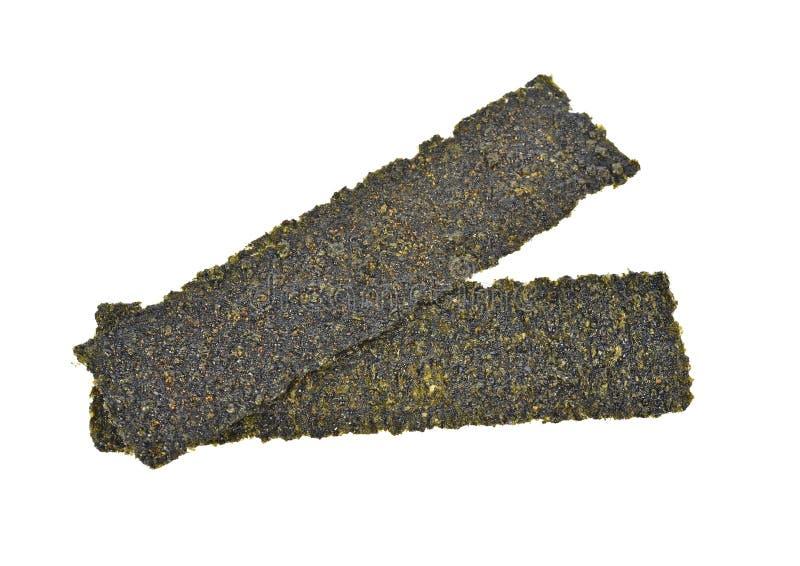Sheet of dried seaweed, Crispy seaweed isolated on white background. The Sheet of dried seaweed, Crispy seaweed isolated on white background royalty free stock photography