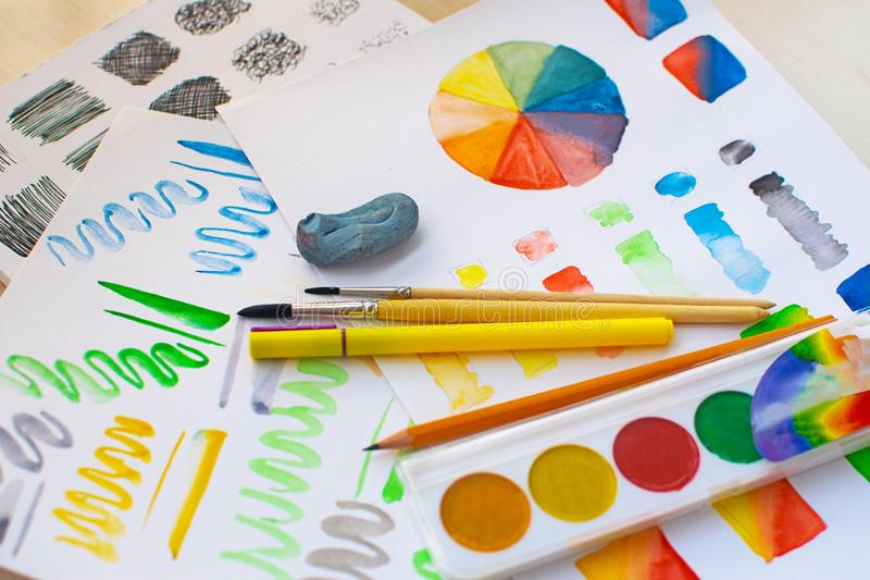 The sheet with exercises: watercolor test items. Color mixing, color wheel and hatching. The sheet with exercises: watercolor mixing, color wheel and hatching royalty free stock image