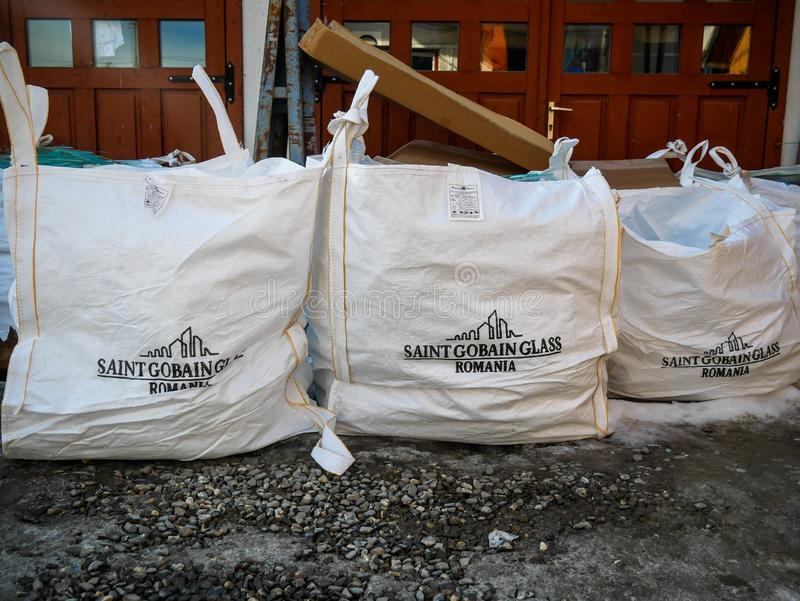 Sheet glass waste in white bags prepared for recycle. stock photography