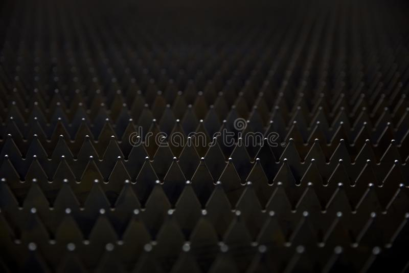 Sheet metal backdrop. Closeup detail of the sharp sheet metal backdrop royalty free stock photos