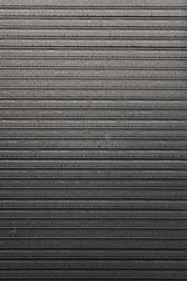 Sheet metal backdrop. Detail of the striped sheet metal surface backdrop royalty free stock image