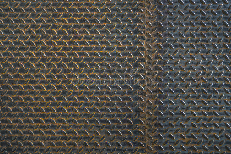 Sheet metal. The floor from an old rusted metal plates as a background royalty free stock image