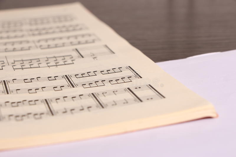 Sheet music. Open sheet music and white paper on desk stock photos