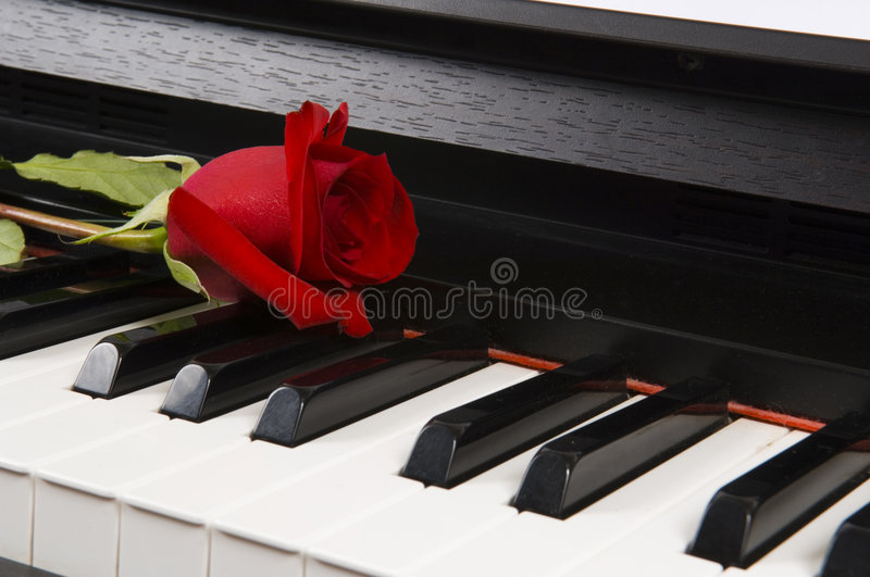 Sheet Music with Rose on piano stock image
