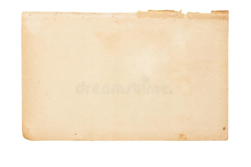 Sheet of old yellowed paper with uneven torn edges on white isolated background. Sheet of old yellowed paper with inclusions, blemishes and uneven torn edges on stock images