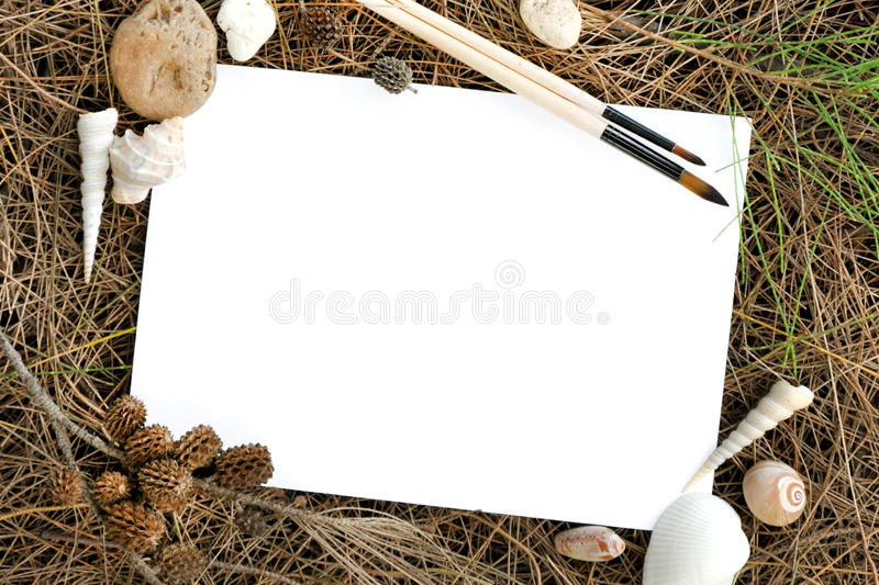 Sheet of paper with composition on the wooden textured table. Blank sheet of paper with composition on the wooden textured table royalty free stock photography