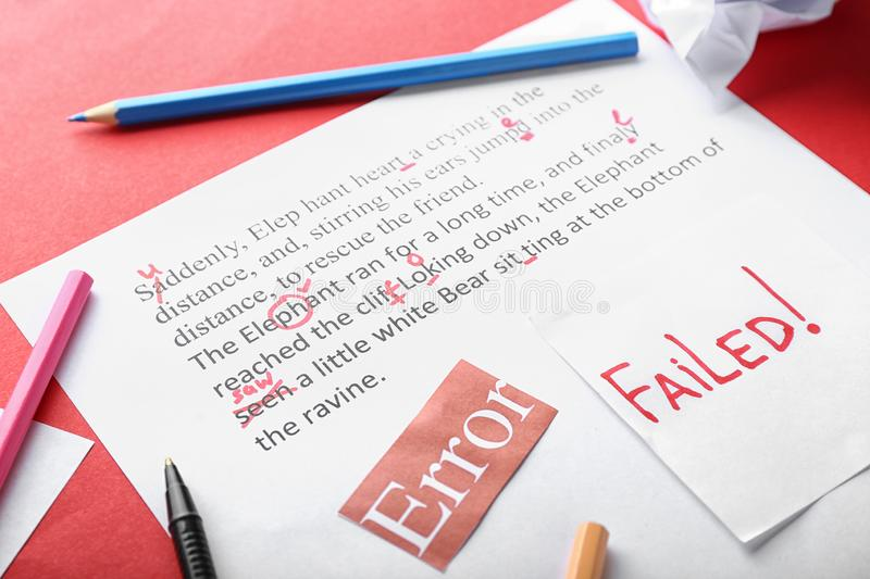 Sheet of paper with corrected mistakes in text on color background, closeup royalty free stock images