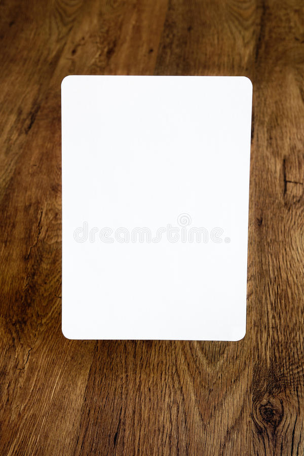Sheet of paper with rounded borders above the old wooden background, open aperture stock image