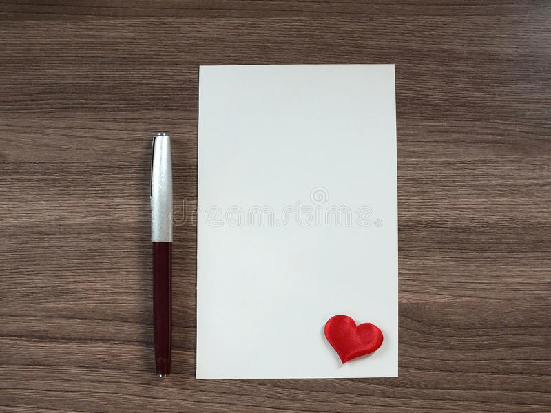 Sheet of paper on the table. Love note on the table royalty free stock photo