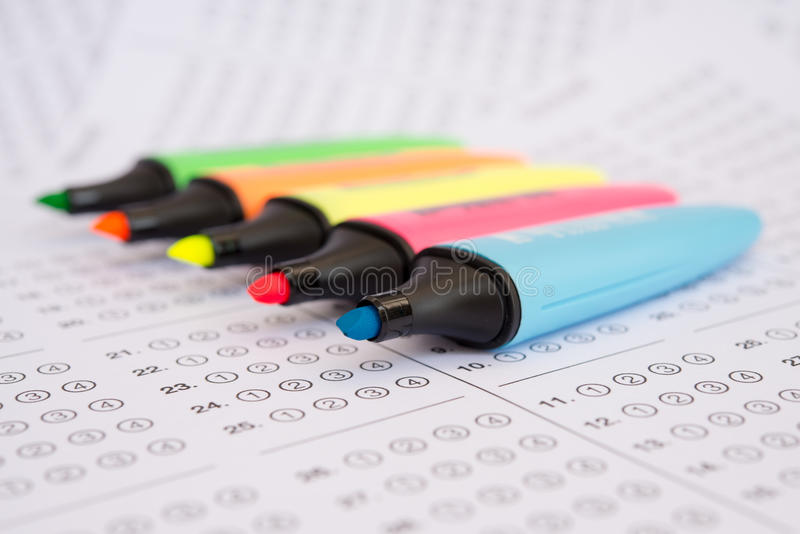 Sheet. Standardized test form with answers bubbled in and a pen, focus on anser sheet stock photo
