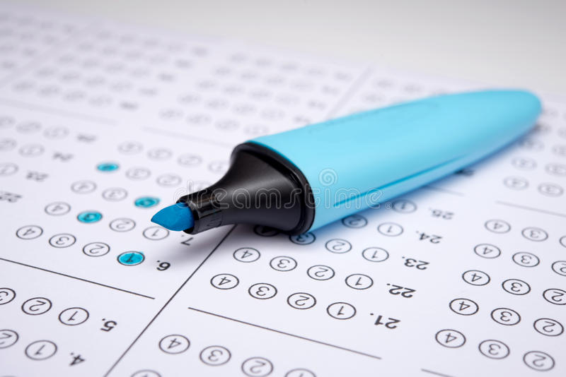 Sheet. Standardized test form with answers bubbled in and a pen, focus on anser sheet stock photos