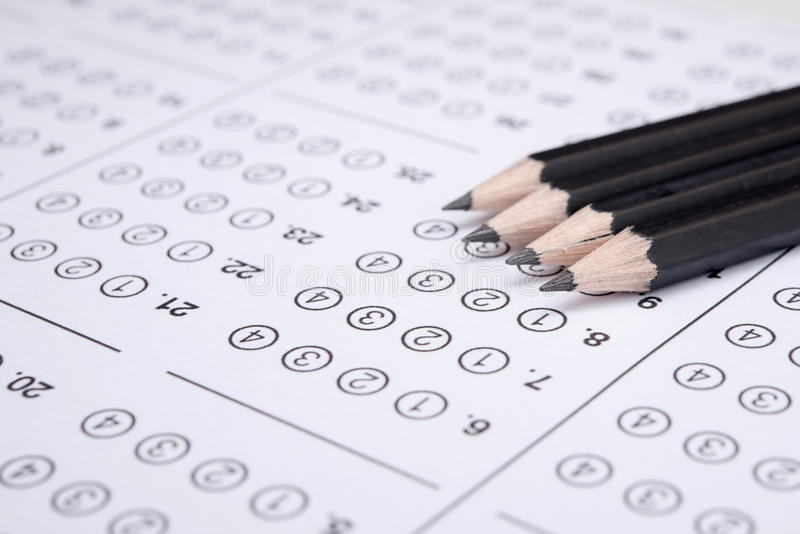 Sheet. Standardized test form with answers bubbled in and a pencil, focus on anser sheet stock photography