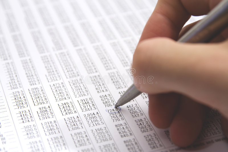 Sheet (table). With numbers - economist in action royalty free stock image