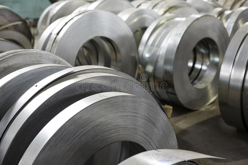 Sheet tin metal rolls. In production hall stock images