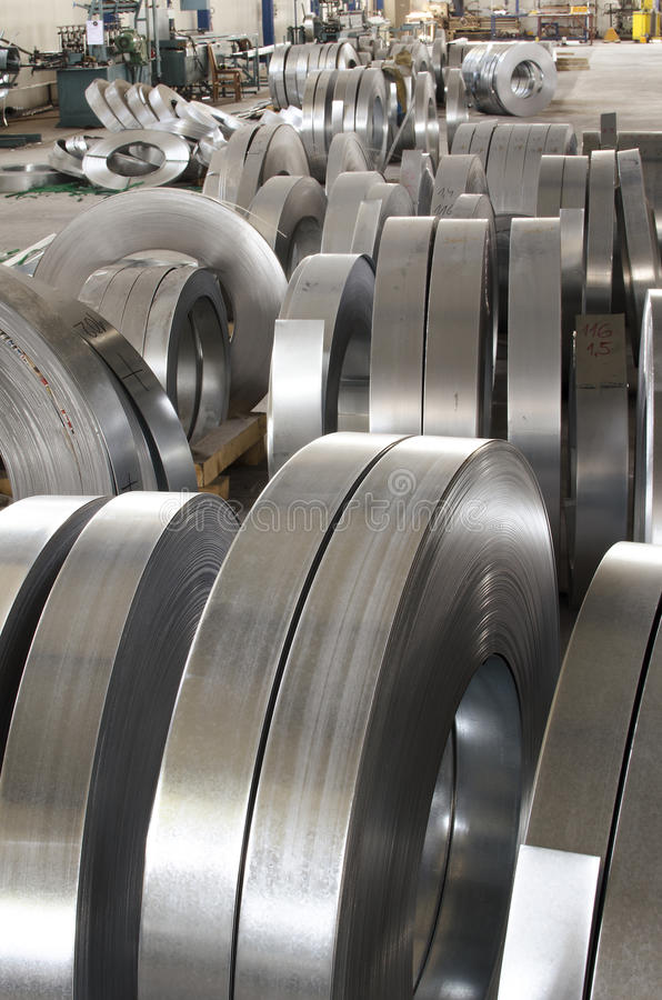 Sheet tin metal rolls. In production hall royalty free stock images