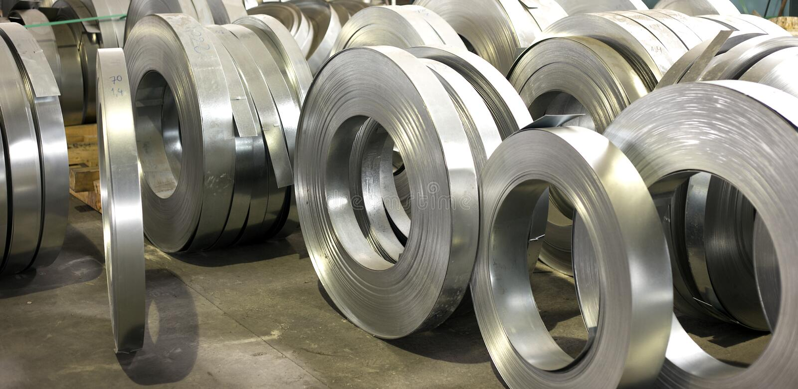 Sheet tin metal rolls. In production hall royalty free stock photo