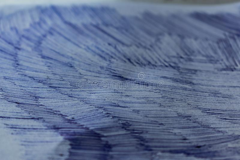 A sheet of white paper with painted dirty strokes, a blue ballpoint pen. Blurred background, shallow depth of field. Drawn record. Incomprehensible scribbles royalty free stock photography