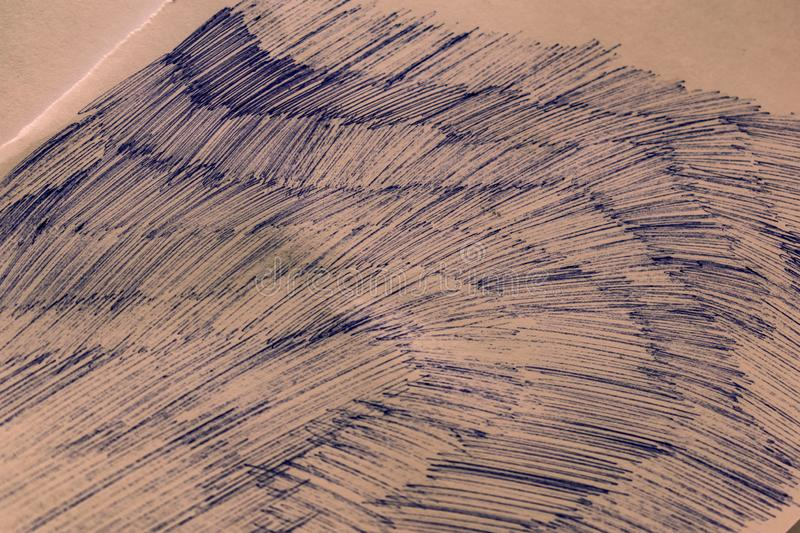 A sheet of white paper with painted dirty strokes, a blue ballpoint pen. Blurred background, shallow depth of field. Drawn record. Incomprehensible scribbles stock photos