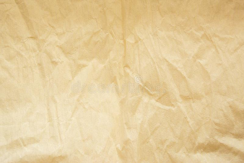 Sheet of worn beige paper as background royalty free stock images