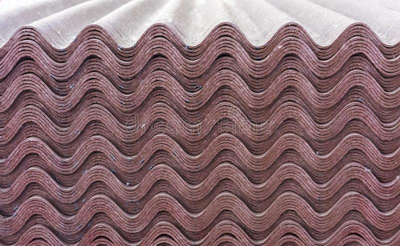 Sheets of brown ondulin. Slate to cover the roof of the house. Background from ondulin.  stock images