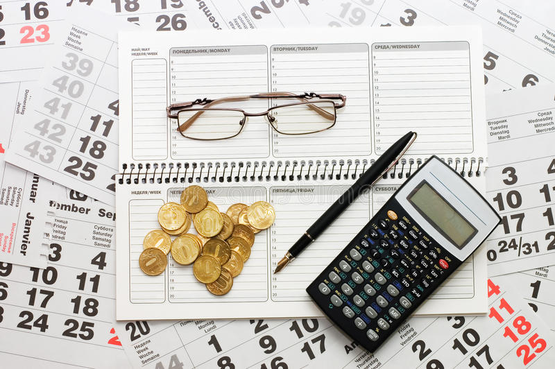 Download Sheets Of A Calendar With Coins And A Notebook Stock Photo - Image: 16757806