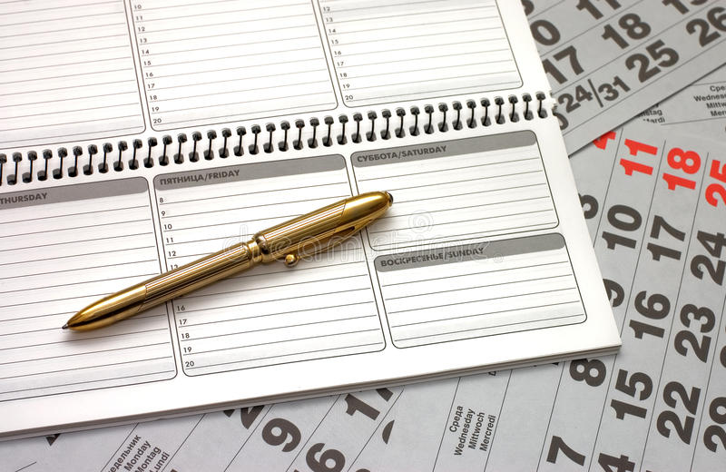 Sheets of a calendar and a notebook stock image