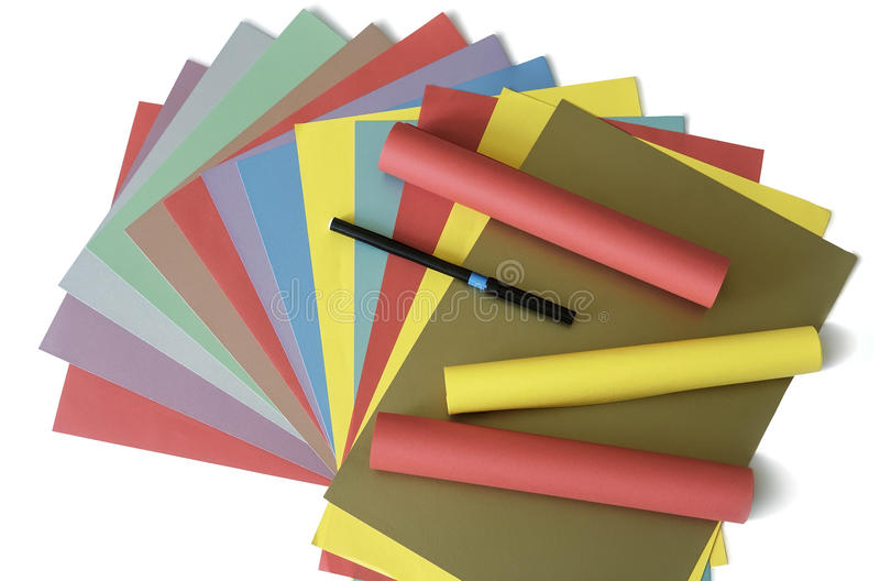 Sheets of colored paper on a white background. stock photo