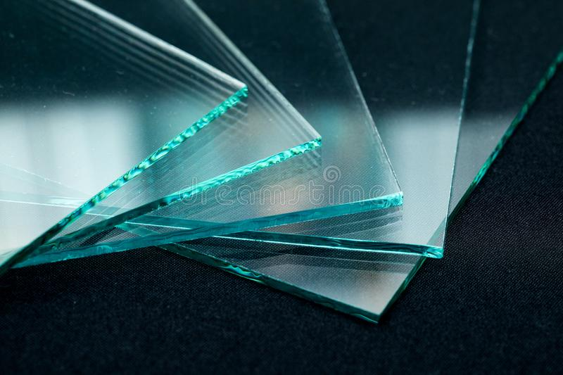 Sheets of Factory manufacturing tempered clear float glass panels cut to size stock photo