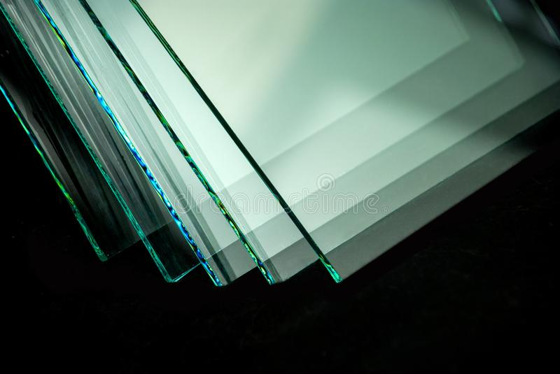 Sheets of Factory manufacturing tempered clear float glass panels cut to size stock image