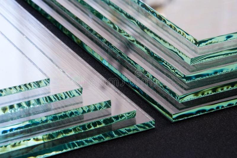 Sheets of Factory manufacturing tempered clear float glass panels cut to size royalty free stock photography