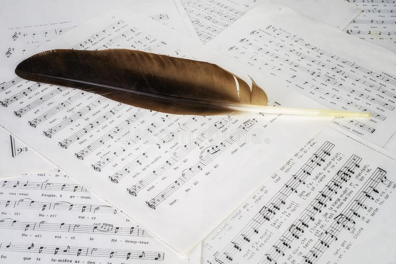 Feather and music sheets stock photos