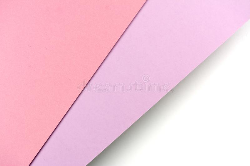 Sheets of paper pink, purple, white colors lined with shade stock images