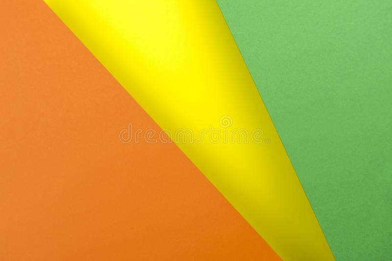 Sheets of paper yellow, green, orange colors lined with shade.  royalty free stock photography