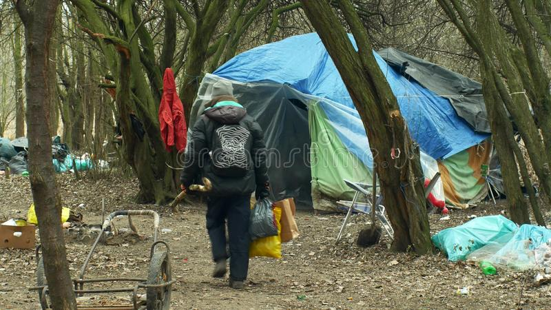 OLOMOUC, CZECH REPUBLIC, JANUARY 2, 2019: Sheets homeless ghetto tent and wood plastic foil chalet building lair people. Sheets tents wood plastic foil against stock photography