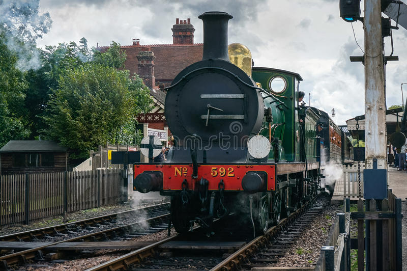 SHEFFIELD PARK, EAST SUSSEX/UK - SEPTEMBER 8 : C Class steam eng. Ine leaving Sheffield Park station East Sussex on September 8, 2013. Unidentified people stock images