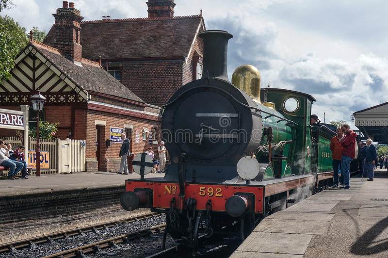 SHEFFIELD PARK, EAST SUSSEX/UK - SEPTEMBER 8 : C Class steam eng. Ine about to leave Sheffield Park station East Sussex on September 8, 2013. Unidentified people royalty free stock images