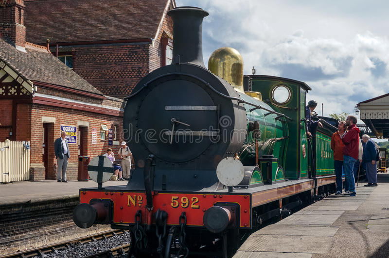 SHEFFIELD PARK, EAST SUSSEX/UK - SEPTEMBER 8 : C Class steam eng. Ine about to leave Sheffield Park station East Sussex on September 8, 2013. Unidentified people stock photos