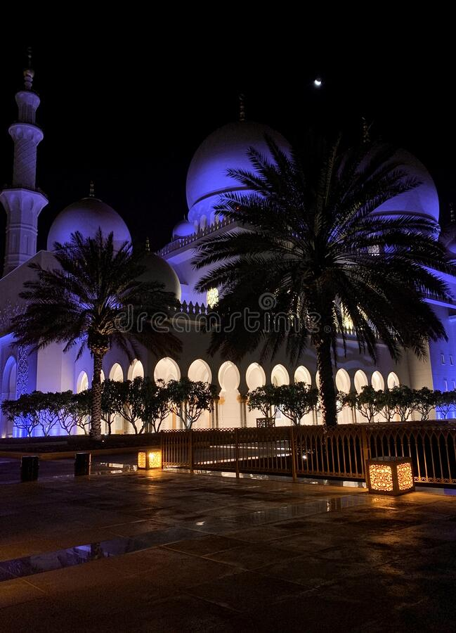 Sheikh Zayed Grand Mosque at night moon sky. The Beautiful mosque at night moon sky abu dhabi stock photo