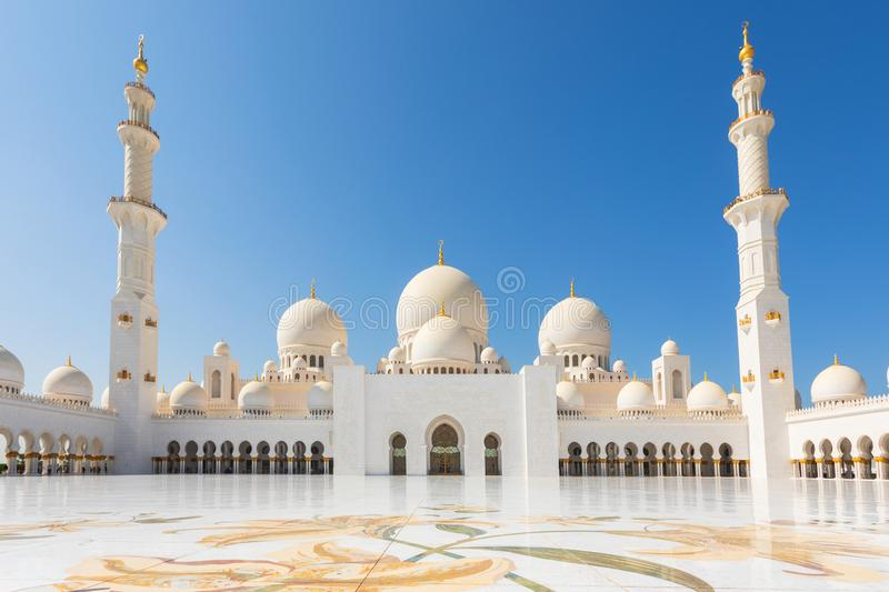 Sheikh Zayed Mosque - Abu Dhabi, United Arab Emirates. Beautiful white Grand Mosque courtyard royalty free stock images