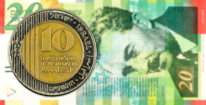 10 shekel coin against 20 israeli new shekel bank note obverse. Specimen royalty free stock photos