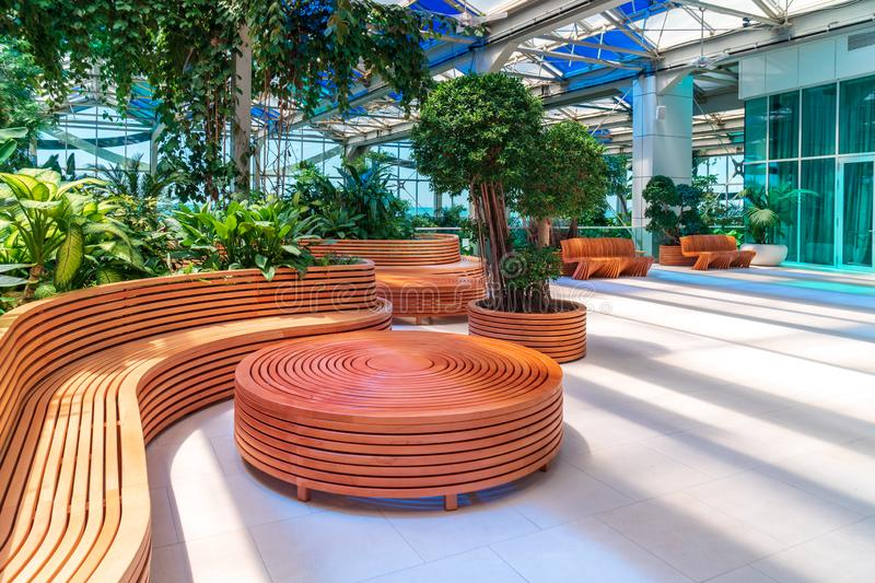 Shekvetili, Georgia - 29.05.2019: Relaxation area with wooden benches and table at Paragraph Hotel stock photo
