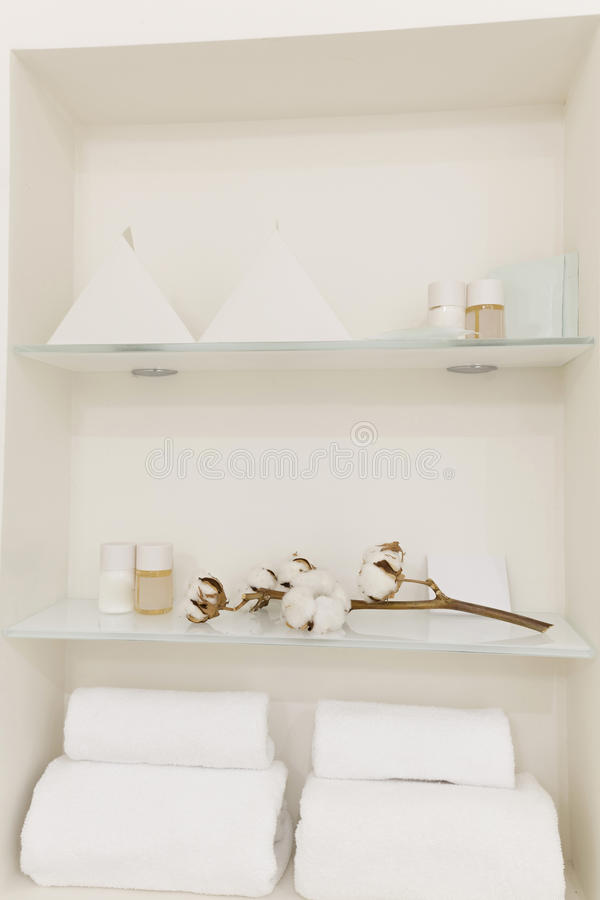 Shelf in the bathroom with bath accessories stock photography